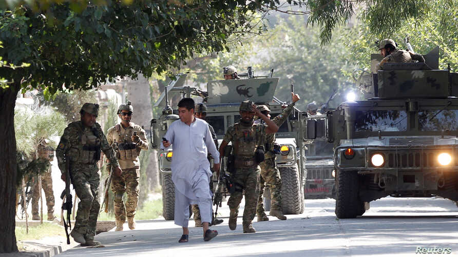 Afghan security forces arrive near the site of an attack in Jalalabad city, Afghanistan, Sept. 18, 2019.
