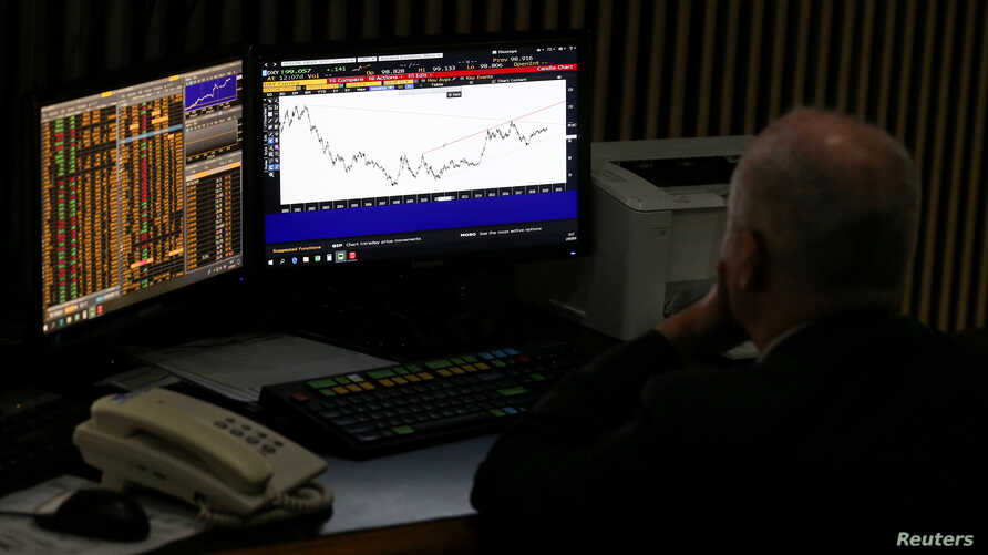 A trader works at the Buenos Aires Stock Exchange, in Buenos Aires, Argentina, Sept. 2, 2019.