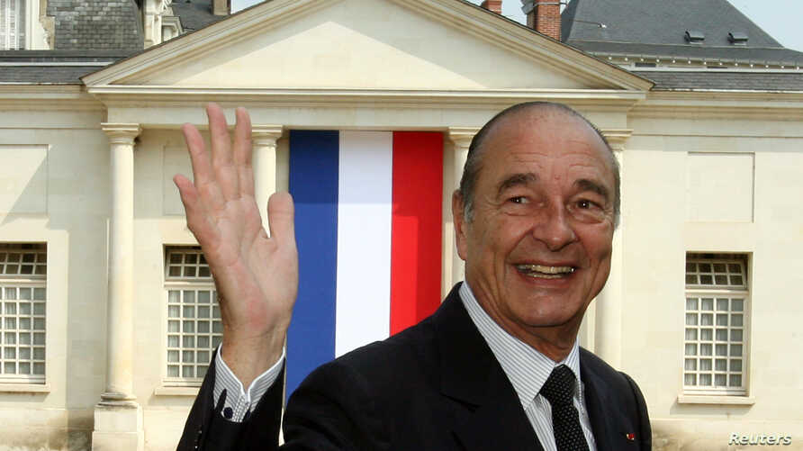 FILE - France's President Jacques Chirac waves as he leaves a French citizenship naturalization ceremony in Tours, central France, June 29, 2006.