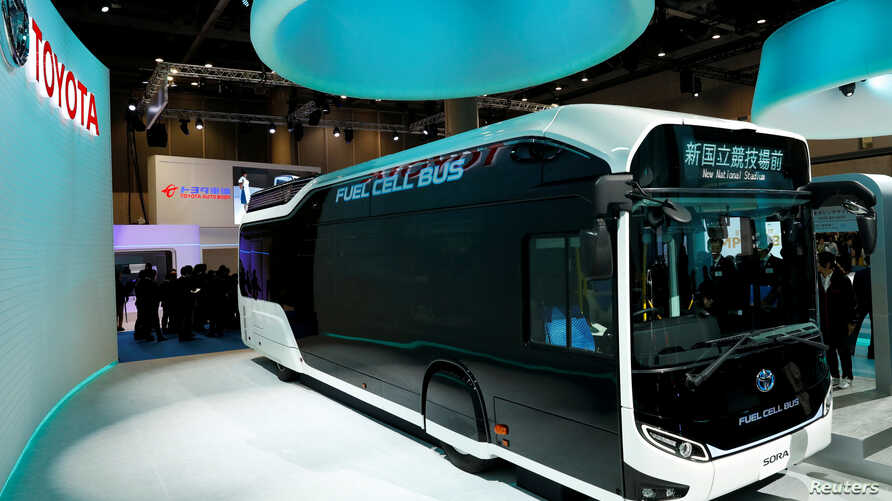 FILE - Toyota Motor Corp. displays the company's fuel cell bus Sora during media preview of the 45th Tokyo Motor Show in Tokyo, Japan, Oct. 25, 2017.