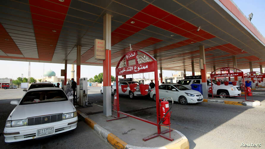 Drivers fill up their vehicles at a gas station in the holy Shi'ite city of Najaf, Iraq, Sept. 16, 2019.