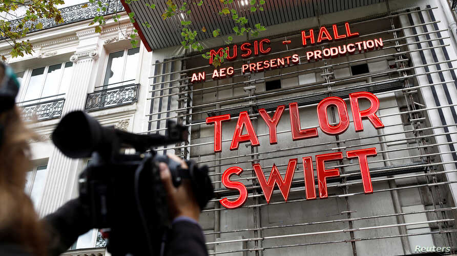 The Olympia Theatre lights up with the name of Taylor Swift prior to her concert performance in Paris, France, Sept. 9, 2019.