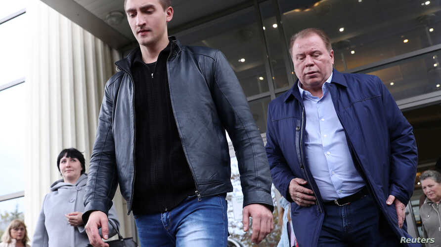 Actor Pavel Ustinov and lawyer Anatoly Kucherena leave a court hearing in Moscow, Russia, Sept. 30, 2019.