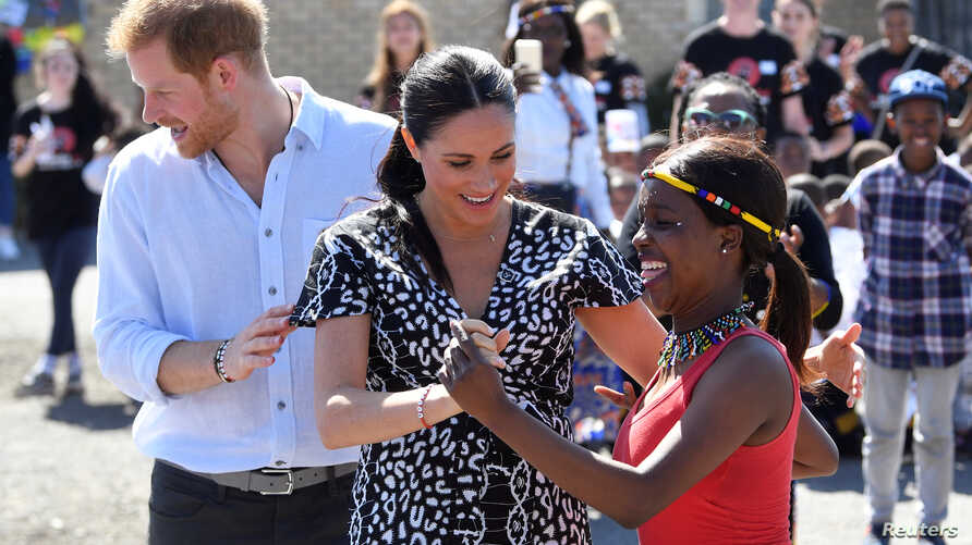 The Duke and Duchess of Sussex, Prince Harry and his wife Meghan, are seen during a Justice Desk initiative in Nyanga township, on the first day of their African tour in Cape Town, South Africa, Sept. 23, 2019.