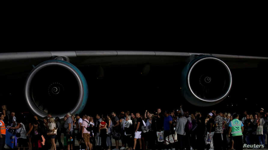 British passengers board an Airbus A380 airliner to transport Thomas Cook customers at Dalaman Airport in Dalaman, Turkey. Thomas Cook, the world's oldest travel firm, collapsed, stranding hundreds of thousands of holidaymakers around the globe.