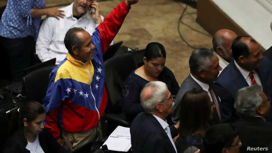 Pro-government lawmakers attend a session of Venezuela's National Assembly in Caracas, Venezuela, Sept. 24, 2019.
