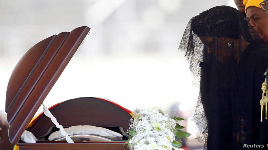 Former first lady of Zimbabwe, Grace Mugabe pays her last respects during a state funeral of her husband and the country's longtime ruler Robert Mugabe, at the national sports stadium in Harare, Sept. 14, 2019.