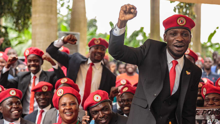 FILE - Singer turned politician Robert Kyagulanyi, also known as Bobi Wine, gestures during a press conference, held at his home in Magere in the outskirts of Kampala, July 24, 2019.