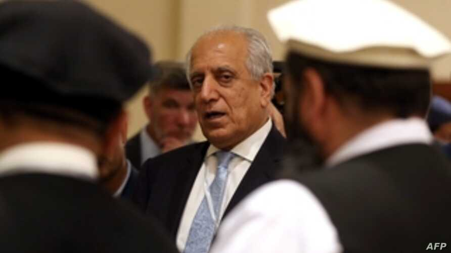 FILE - U.S. Special Representative for Afghanistan Reconciliation Zalmay Khalilzad attends the Intra Afghan Dialogue talks in the Qatari capital, Doha, July 8, 2019.