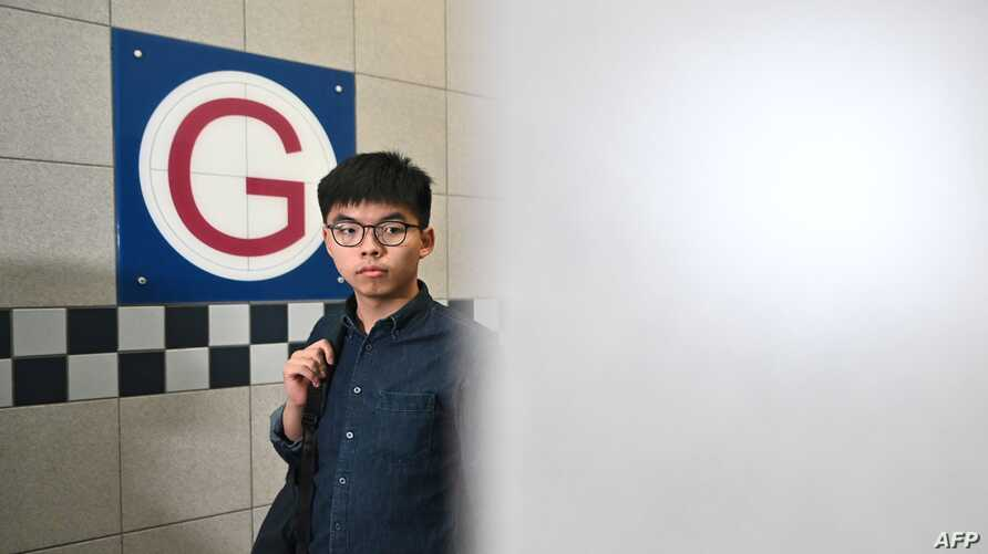 Pro-democracy activist and South Horizons community organiser Joshua Wong arrives at the Southern district office as he…