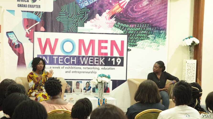 Aseda Addai-Deseh, left, and Lily Edinam Botsyoe speak to participants at the Women in Tech Week in Accra. (S. Knott/VOA)