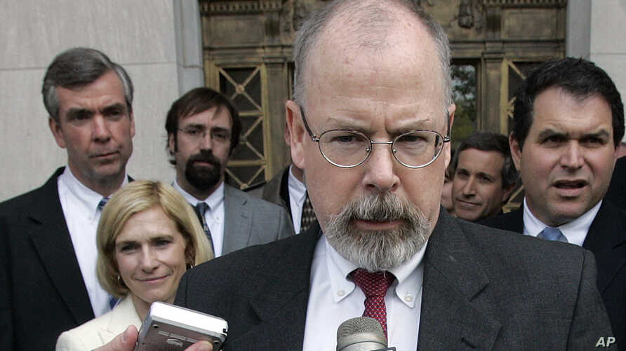 FILE - In this April 25, 2006, file photo, John Durham speaks to reporters on the steps of U.S. District Court in New Haven,…