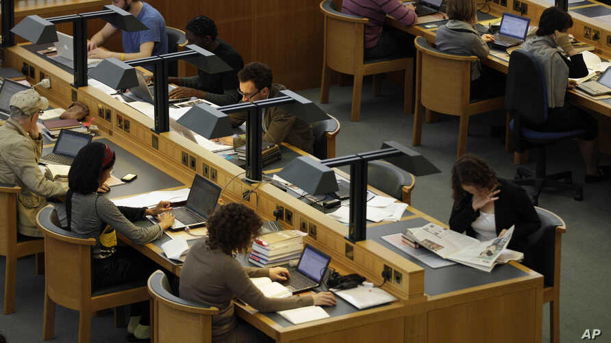 People work on laptops in a reading room at the British Library in London, Monday, June 20, 2011. A treatise on a stuffed…