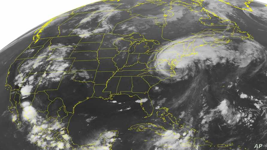 FILE - A 2019 NOAA satellite image shows Hurricane Irene, a category 2 storm with winds up to 100 mph and located about 400 miles southeast of Nassau.  A study published Oct. 14, 2019, says scientists have discovered 'stormquakes,' which are a mash-up of hurricanes and earthquakes.