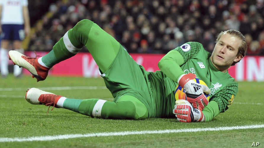 Liverpool goalkeeper Loris Karius gathers in the ball during the English Premier League soccer match between Liverpool and Tottenham Hotspur at Anfield in Liverpool, England,  Feb. 4, 2018.