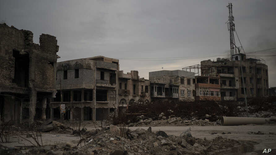 This April 14, 2019 photo shows debris from buildings destroyed during the war in Mosul, Iraq. In the summer of 2014, nearby…