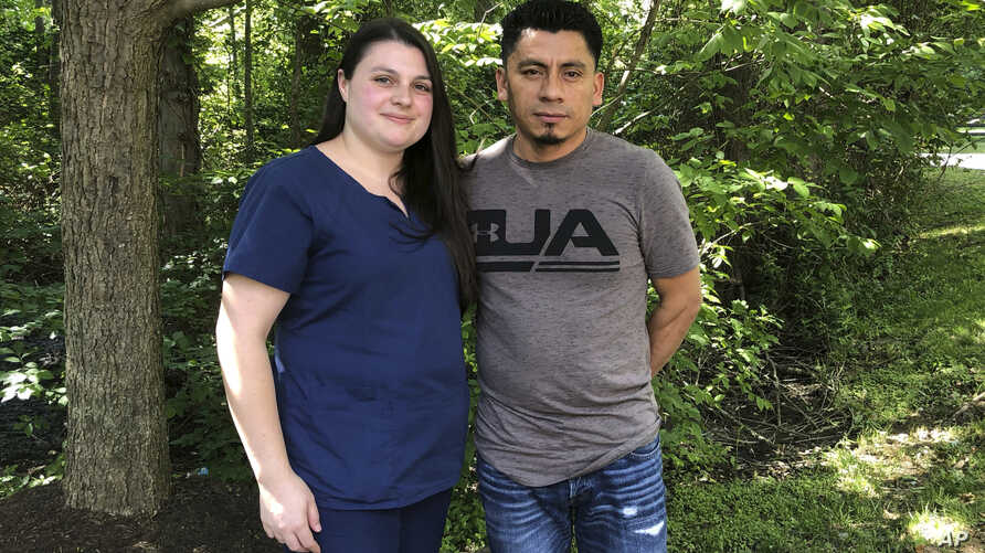 Alyse Sanchez and her husband, Elmer Sanchez, pose for The Associated Press in Sandy Spring, Md, June 21, 2019.