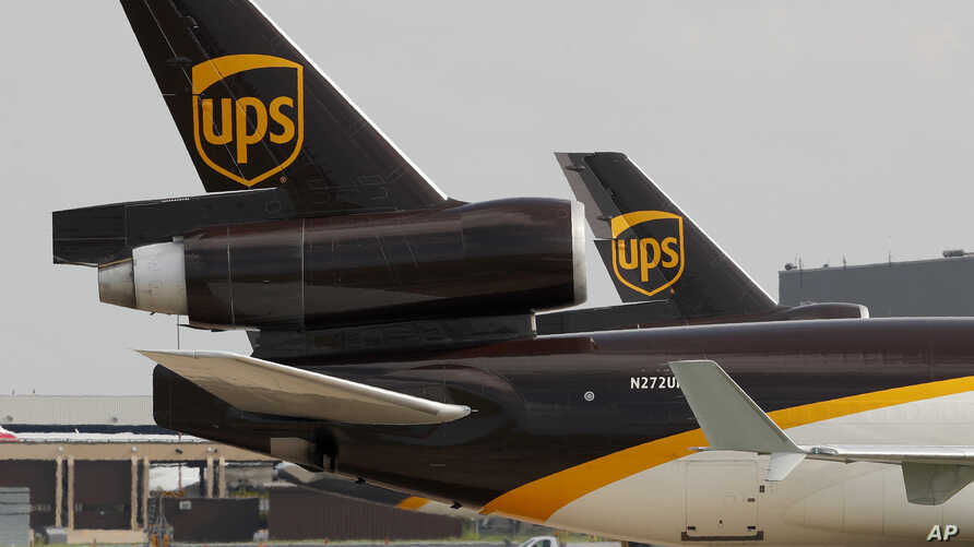 FILE - A UPS aircraft taxis to its hangar area after it arrived at Dallas-Fort Worth International Airport in Grapevine, Texas, June 24, 2019.