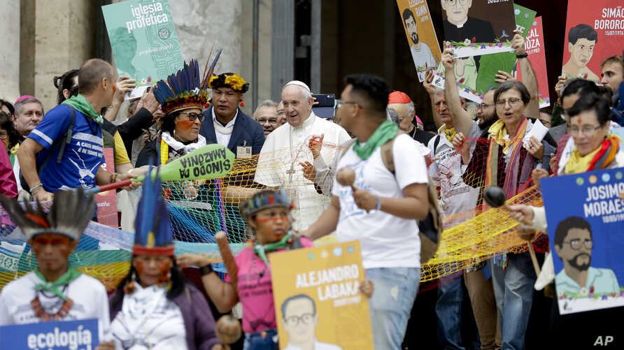 Pope Francis walks in procession on the occasion of the Amazon synod, at the Vatican, Oct. 7, 2019.