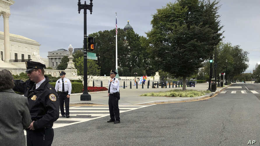 The streets outside the front of the Supreme Court are closed off for a suspicious package, Tuesday morning, Oct. 8, 2019 in…