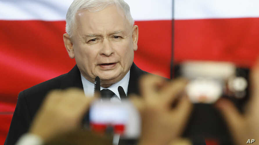 Leader of Poland's ruling party Jaroslaw Kaczynski speaks in reaction to exit poll results right after voting closed in the nation's parliamentary election that is seen crucial for the nation's course in the next four years, in Warsaw , Poland, Oct. 13, 2019.