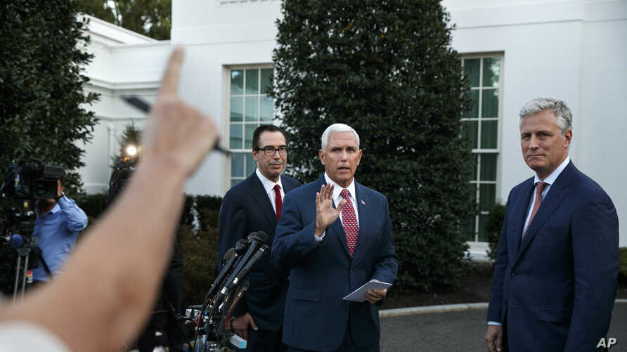 Vice President Mike Pence, center, with Treasury Secretary Steven Mnuchin, left, and White House national security adviser…