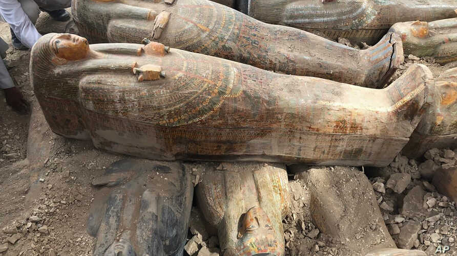 This photo provided by the Egyptian Ministry of Antiquities shows recently discovered ancient colored coffins with inscriptions and paintings, in the southern city of Luxor, Egypt, Oct. 15, 2019.