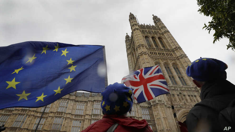 Anti-Brexit demonstrators waves flags near Parliament in London, Thursday, Oct. 17, 2019. UK Prime Minister Boris Johnson on…