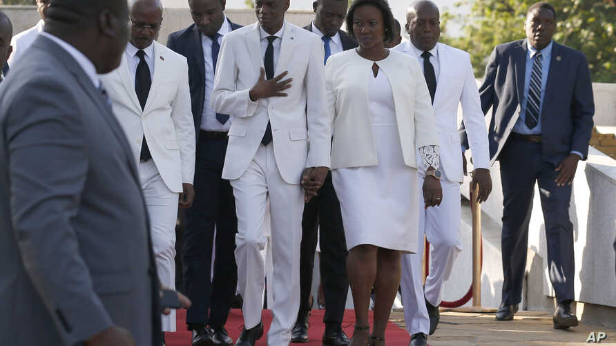 Accompanied by First Lady Martine Moïse, center right, and and acting prime minister Jean Michel Lapin, center left, President…