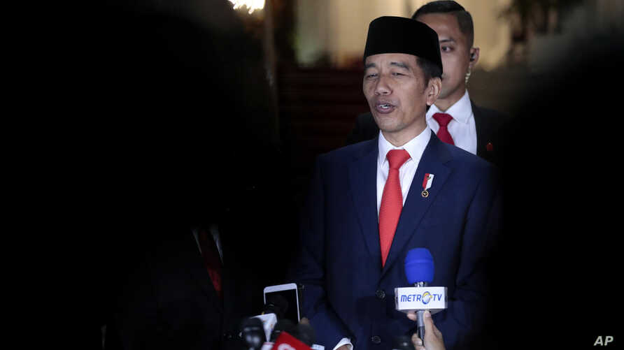 Indonesian President Joko Widodo speaks to the media upon arrival from his inauguration for his second term, at Merdeka Palace in Jakarta, Indonesia, Oct. 20, 2019.