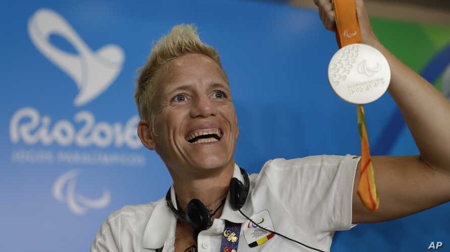 FILE - Belgium's Marieke Vervoort poses for the photo as she holds her silver medal at a press conference during the Rio Paralympic games in Rio de Janeiro, Brazil, Sept. 11, 2016.