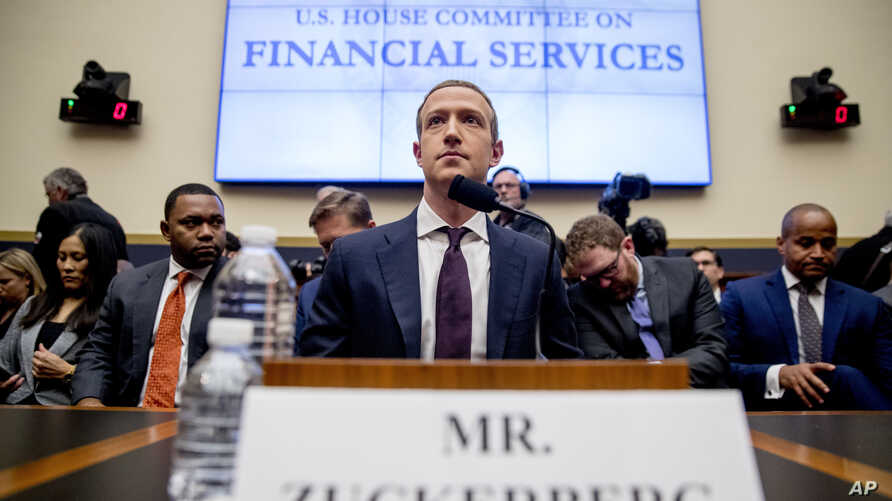 Facebook CEO Mark Zuckerberg arrives for a House Financial Services Committee hearing on Capitol Hill in Washington, Wednesday,…