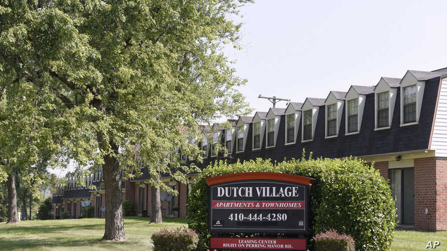FILE - In this July 29, 2019, photo, a sign sits outside the Dutch Village apartments and townhomes, owned by the Kushner Cos.,…