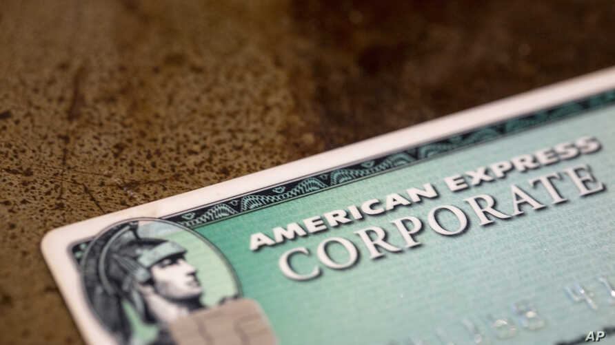 FILE - This Aug. 11, 2019, file photo shows an American Express card in New Orleans. Launched in 1969, the Green Card gave…