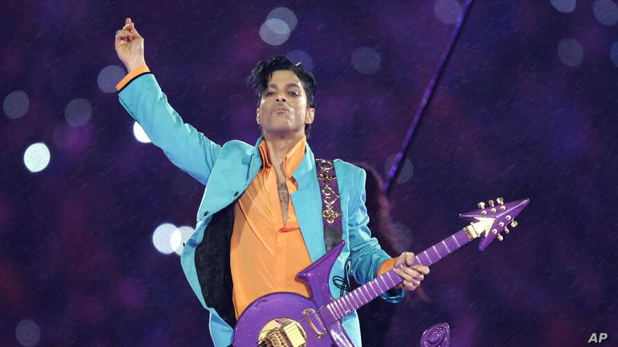 FILE - In this Feb. 4, 2007, file photo, Prince performs during the halftime show at the Super Bowl XLI football game in Miami…