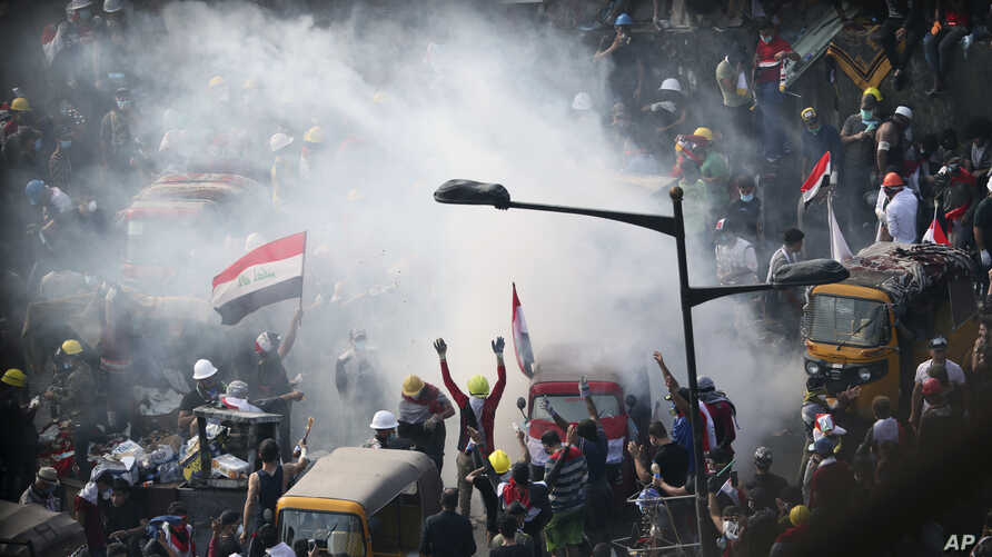 Iraqi security forces use tear gas to disperse anti-government protesters in Baghdad, Iraq, Wednesday, Oct. 30, 2019. (AP Photo…