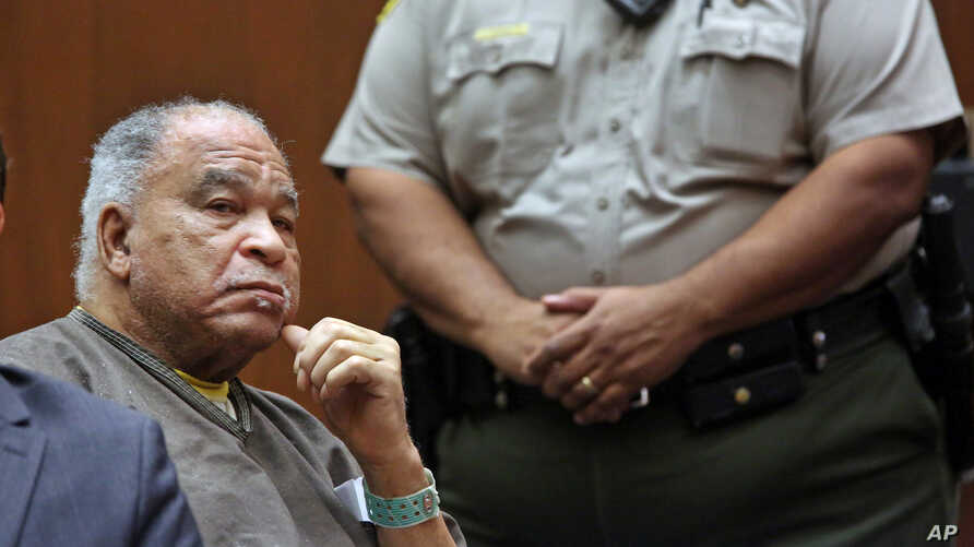 FILE - Samuel Little listens as he is sentenced to three consecutive terms of life in prison without parole for murdering three women in the late 1980s, in a Los Angeles courtroom, Sept. 25, 2014.