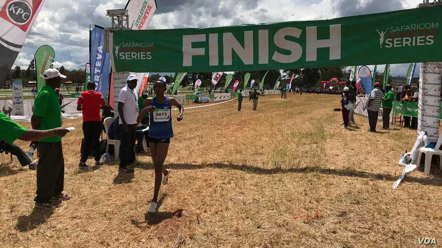 An athlete finishes the Ndalat cross country championship race. Some athletes have come to compete after years of training on their own. (M. Yusuf/VOA)