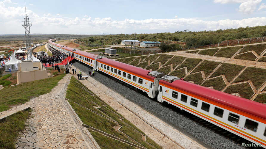 A general view shows a train on the Standard Gauge Railway (SGR) line constructed by the China Road and Bridge Corporation …