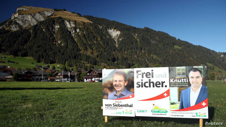 Election posters of the Swiss People's Party (SVP) candidates are pictured, days ahead of federal elections, in Lenk,…