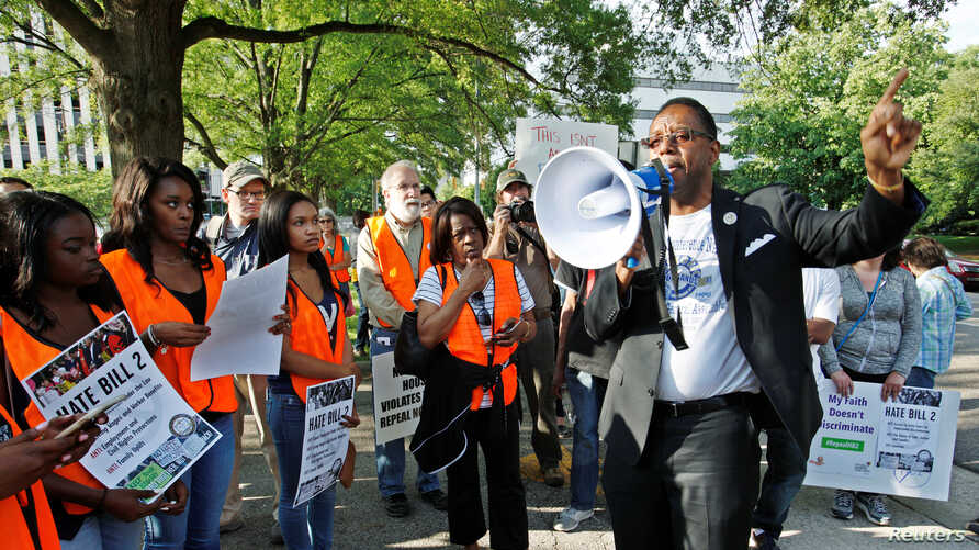 FILE - The Rev. Curtis Gatewood, one of the NAACP's leaders in North Carolina, speaks during a demonstration outside the state legislature in Raleigh, North Carolina, May 16, 2016.