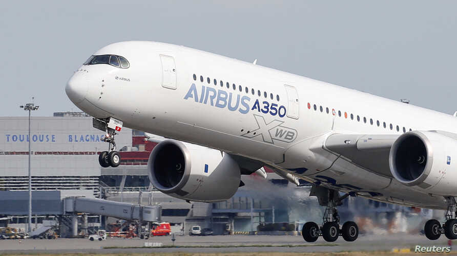 FILE - An Airbus A350 takes off at the aircraft builder's headquarters in Colomiers near Toulouse, France, Sept. 27, 2019.