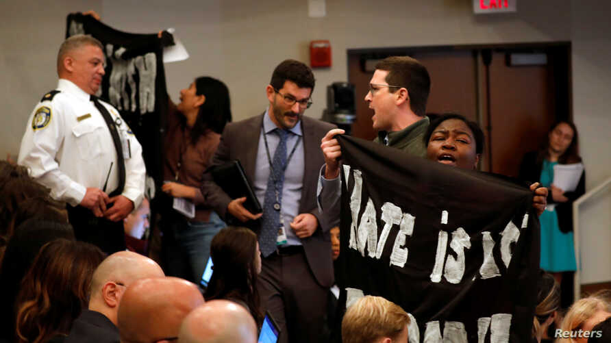 Protesters interrupt remarks by Acting Department of Homeland Security (DHS) Secretary Kevin McAleenan at the Migration Policy Institute annual Immigration Law and Policy Conference in Washington, Oct. 7, 2019.