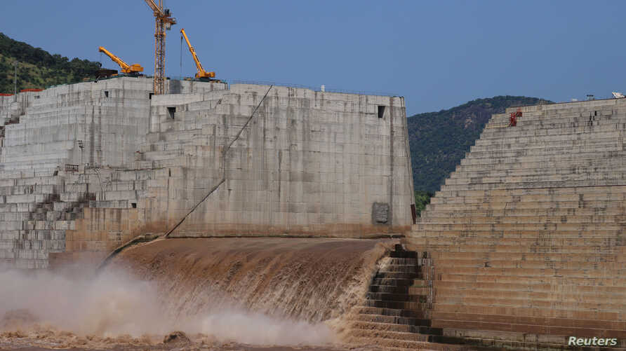 FILE PHOTO: Water flows through Ethiopia's Grand Renaissance Dam as it undergoes construction work on the river Nile in Guba…
