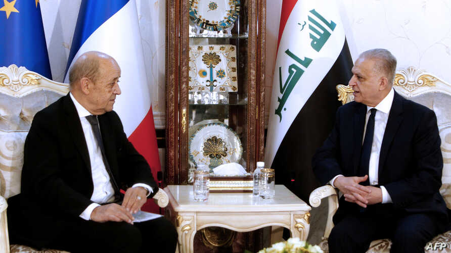 Iraqi Foreign Minister Mohammed Ali al-Hakim (R) meets his French counterpart Jean-Yves Le Drian in Baghdad on October 17, 2019…