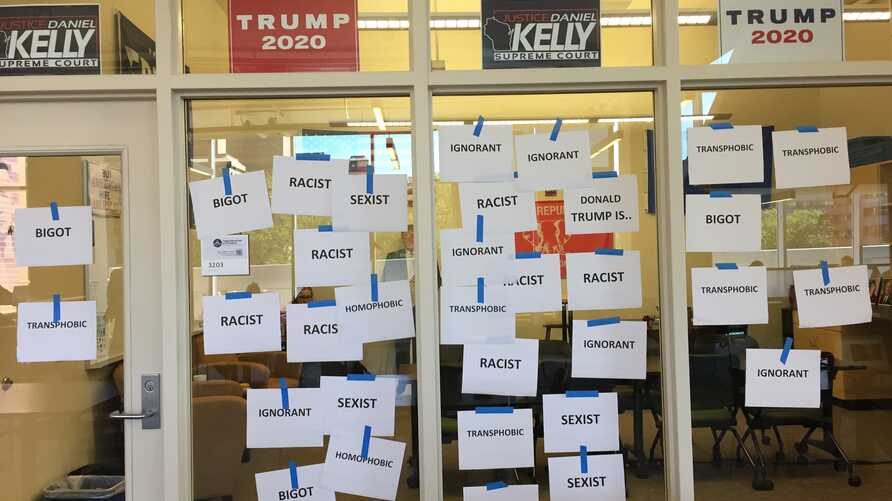 Anti-Trump messages are sen posted on window panels outside the GOP Badgers room at the Student Activities Center on campus at the University of Wisconsin-Madison. (Credit - Jasmine Kiah)