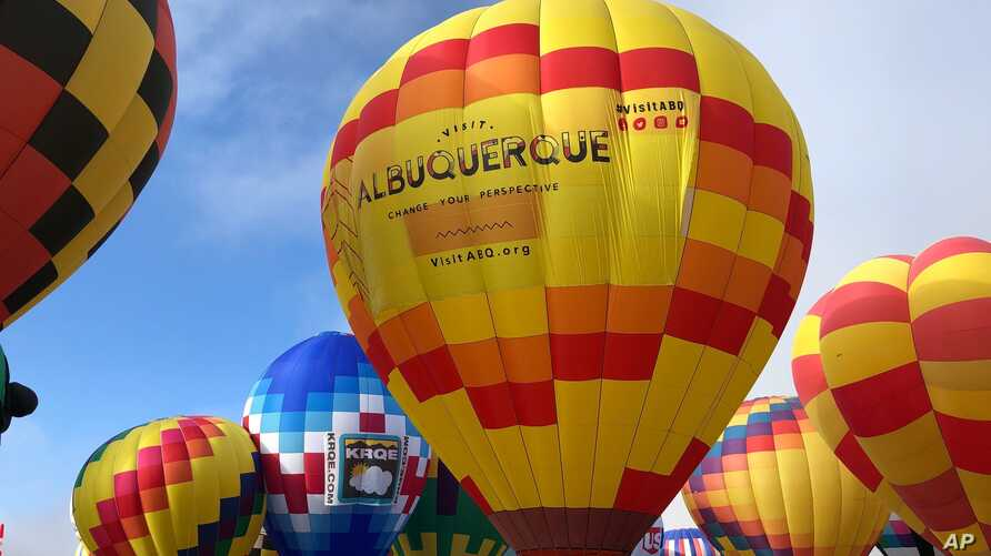 Hot air balloons are inflated during the annual Albuquerque International Balloon Fiesta in Albuquerque, N.M., Oct. 5, 2019.