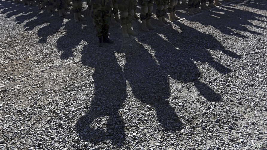FILE - Members of Afghan special forces attend a ceremony on the outskirts of Kabul, Afghanistan, Oct. 25, 2017. Human Rights Watch alleges that CIA-trained paramilitary forces operate outside of the regular chain of commmand in the country.