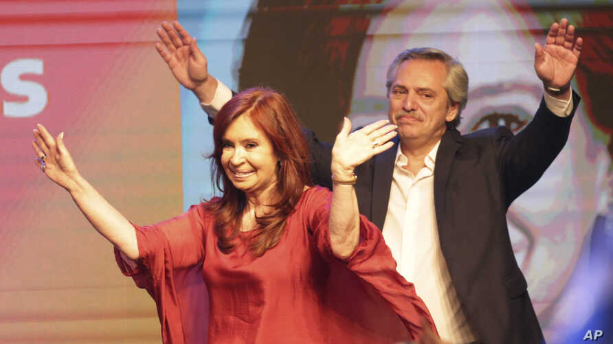 Peronist presidential candidate Alberto Fernández, behind, and running mate, former President Cristina Fernández, celebrate after the election results in Buenos Aires, Argentina, Oct. 27, 2019.