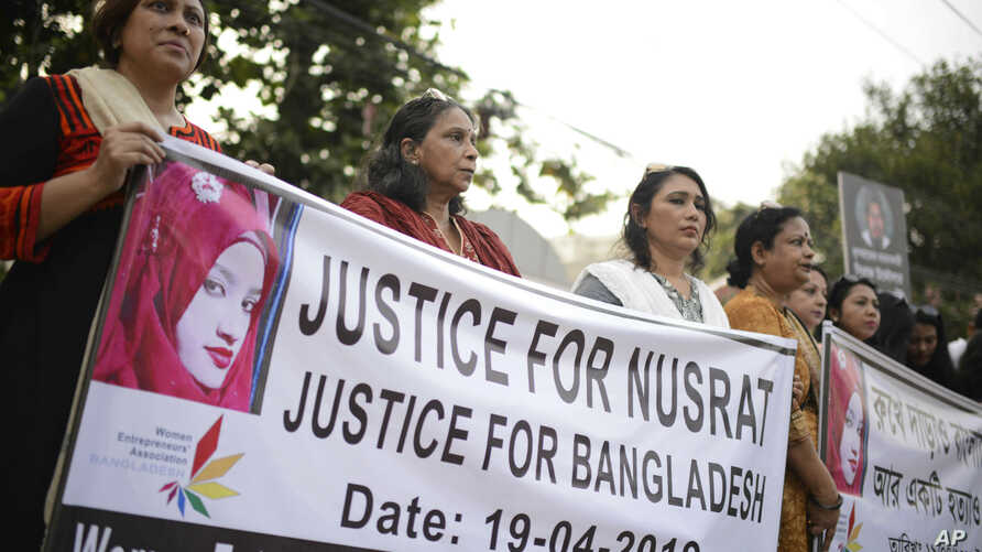 FILE - Protesters demand justice for an 18-year-old Nusrat Jahan Rafi who was killed after she was set on fire for refusing to drop sexual harassment charges against her Islamic school's principal, in Dhaka, Bangladesh, April 19, 2019.